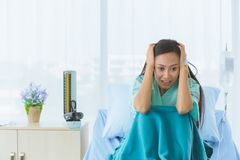 Female patient shows despair with her illness stock photos