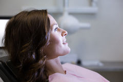 Female patient sitting on dentist chair Stock Photos