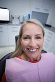 Female patient sitting on dentist chair Stock Photography