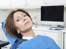 Female Patient Sitting At Dentist's Clinic Stock Photos