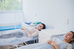 Female patient sleeping in medical bed at the hospital ward Stock Images