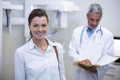 Female patient smiling at dental clinic Royalty Free Stock Photo