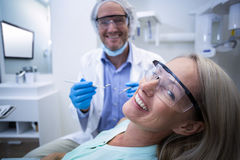 Female patient smiling while getting treatment Royalty Free Stock Photos