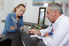 Female patient taking appointment at hospital reception. Female patient taking an appointment at the hospital reception stock photos