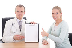Female patient thumbs up and doctor holding folder with copyspac Royalty Free Stock Photo