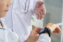 Female Patient Using Smartwatch royalty free stock photos