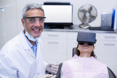 Female patient virtual reality headset during a dental visit Royalty Free Stock Photos
