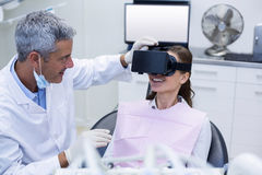 Female patient virtual reality headset during a dental visit Royalty Free Stock Images