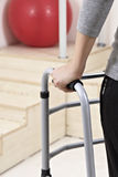 Female patient with walker Royalty Free Stock Images