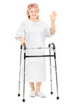 Female patient with walker waving with hand Stock Image