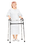 Female patient walking with walker Stock Images