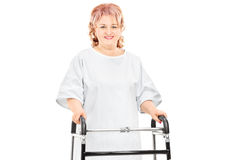 Female patient walking with walker Royalty Free Stock Image
