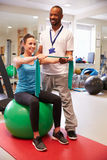 Female Patient Working With Physiotherapist In Hospital Stock Images