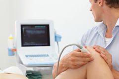 Female patients knee joint dynamic test - ultrasound Royalty Free Stock Photo