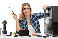 Female PC technician posing by a computer Royalty Free Stock Image