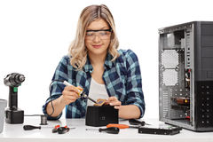 Female PC technician soldering a chip Stock Photo