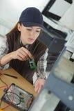 Female pc technician working stock photo