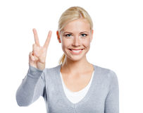 Female peace gesturing Royalty Free Stock Photography