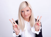 Female peace gesturing with hand, isolated on white Royalty Free Stock Photos