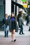 Female Pedestrian Walking at a Cross Walk in a City royalty free stock photos