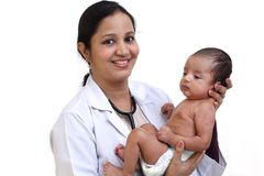 Female pediatrician holds newborn baby. Against white background royalty free stock images
