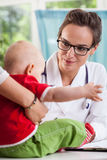 Female pediatrician with little patient Royalty Free Stock Images