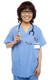 Female pediatrician ready with a syringe Royalty Free Stock Images