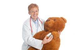 Female pediatrician with teddy bear Stock Image