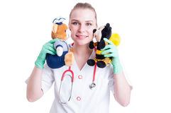 Female pediatrics doctor with plush as medical care for children Royalty Free Stock Image