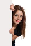 Female peeking from behind sign Royalty Free Stock Images