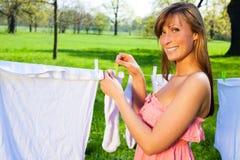 Female  peg out washing Royalty Free Stock Photography