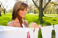 Female  peg out washing Royalty Free Stock Photo