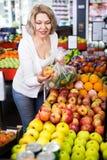 Female pensioner buying fresh fruits Stock Image