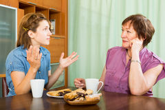 Female pensioner chatting with her daughter Stock Images