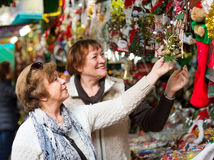 Female pensioners buying X-mas decorations Royalty Free Stock Photo
