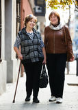 Female pensioners at city walk Stock Photography