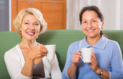 Female pensioners drinking tea Royalty Free Stock Photography