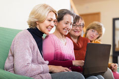Female pensioners with laptop indoor Stock Photography
