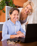 Female pensioners with laptop indoor Royalty Free Stock Photography