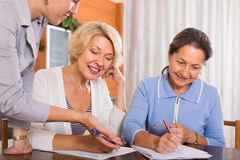Female pensioners with public notary Royalty Free Stock Photo
