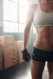 Female with perfect body standing at the gym Stock Photos