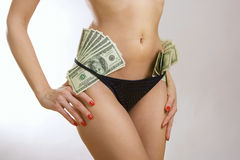 Female perfect sexy body and dollar banknotes money Stock Image