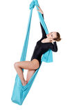 Female performer hanging on aerial silk Royalty Free Stock Image
