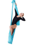 Female performer hanging on aerial silk Stock Photos