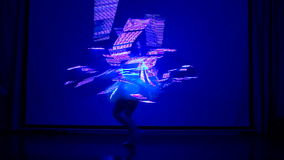 Female performs LED show at night. stock footage