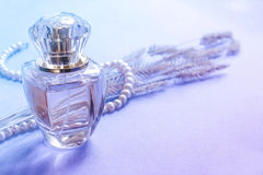 Female perfume in a glass bottle, a gift for a girl. Fragrance Royalty Free Stock Photo