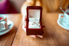 Female person hand with golden wedding ring Royalty Free Stock Photo