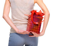 Female person hide behind back the big present box Royalty Free Stock Photos