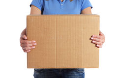 female person holding a moving box Royalty Free Stock Image