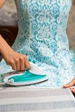 Female person ironing dress clothed in it royalty free stock photo